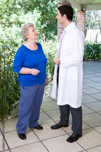 Old woman talking to a doctor