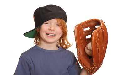 Portrait of a laughing red haired girl with baseball cap