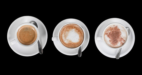 coffe cups from the top isolated over a dark background