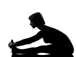 woman paschimottanasana yoga pose