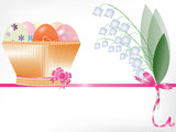 Basket with Easter eggs and a bouquet of lilies of the valley