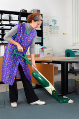 professional cleaning lady at her work in the office
