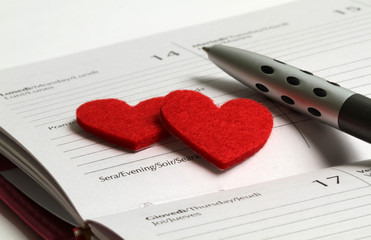 Pen, heart and notebook