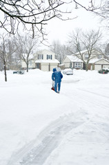 Man Clearing Driveway with a Snow Blower