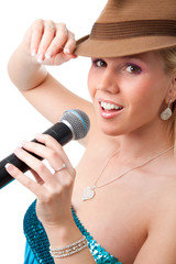 Happy girl with brown hat singing in microphone.