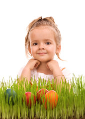 Happy easter girl with colorful eggs in fresh grass