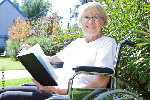 Happy pensioner reading a book