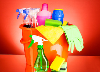Cleaning supplies on red background