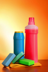 assorted cleaning products on  yellow background
