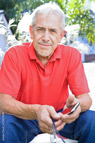 Elder man with  a phone
