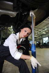 woman lift car in repair center