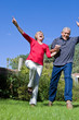 Happy elder couple jumping