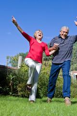 Happy elder couple jumping