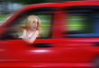 Woman Driving Red Car with Speed