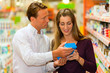 couple in supermarket choosing groceries