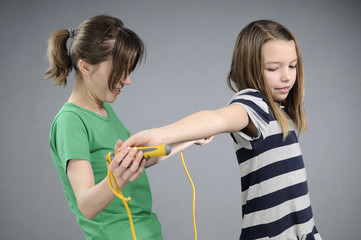 gym instructor teaching girl jumping rope