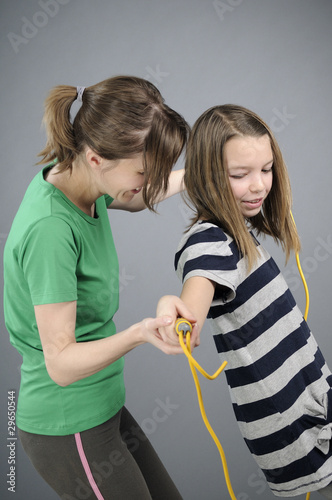 sport educator teaching teenager jumping rope