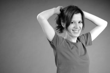 joyful aerobic instructor arranging hair