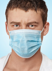 Doctor with surgical mask concerned