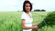 Happy young woman on cereal field in summer - Outdoor