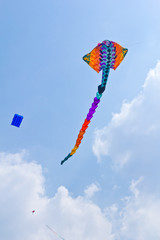 colorful rays kite against blue sky