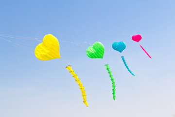 colorful love heart kite against blue sky
