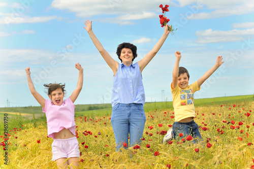 family on poppy field