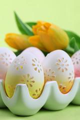 Flowery Easter eggs in an egg holder
