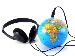 Headphones plugged into a globe - Worldwide music concept #4