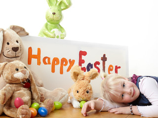 Cute blond child is waiting for Easter