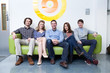 Group of people sitting on couch in office