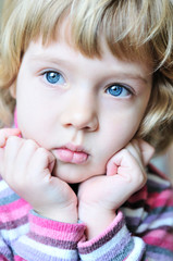 thoughtful blonde child