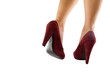 piedi femminili con scarpe rosse