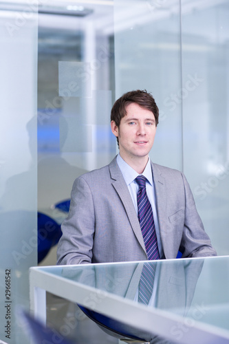 Smiling businessman sitting at conference table