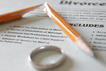A Divorce Petition, Broken Pencil and Gold Wedding Band