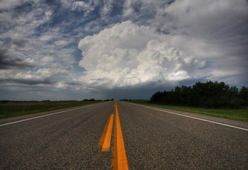 Storm clouds down a Saskatchewan highway