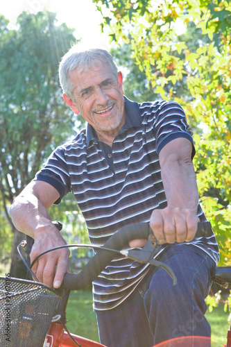 Elder man riding a bike