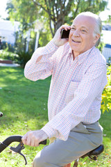 Elder man making a call