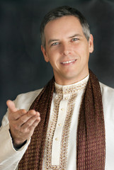 Man in Traditional Indian Clothing Gestures To Camera