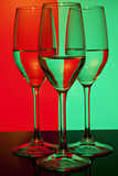 Three beatiful wine glasses with red and green