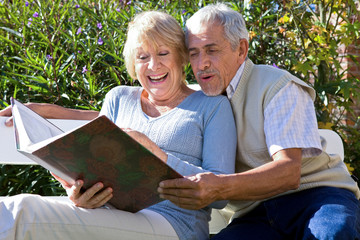 Happy couple viewing a photoalbum