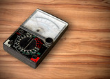 volt meter on wooden table poster