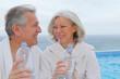 Portrait of happy senior couple in spa center