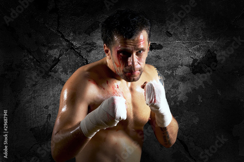 Aggressive boxer with blood on the face