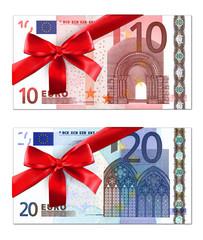 Geldscheine mit roter Geschenkschleife