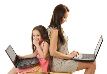 Mother and daughter using laptops