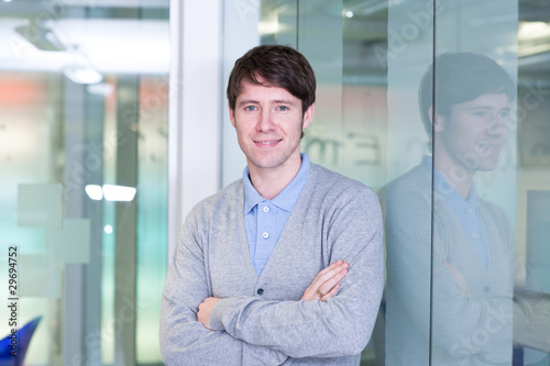 Confident young man in office