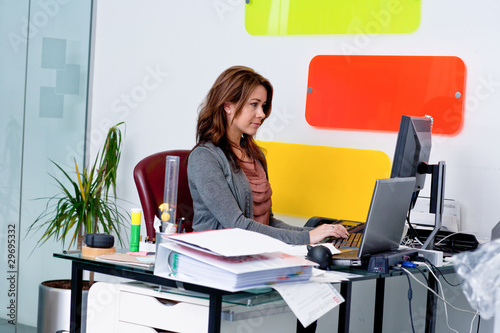 Young woman working at computer in office
