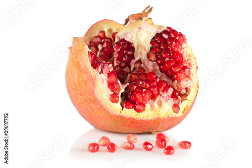 Ripe pomegranate isolated on white background