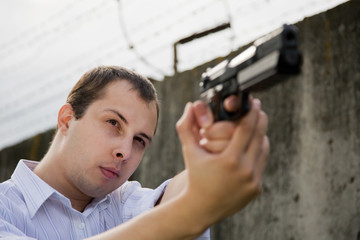 man aiming a black gun